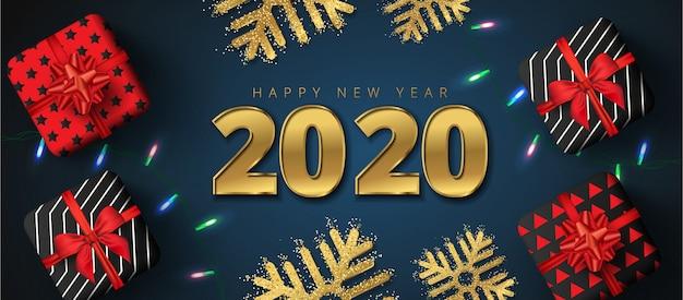 Letras de venta de feliz año nuevo 2020, cajas de regalo, copos de nieve dorados y guirnaldas de luces brillantes