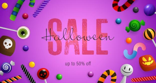 Letras de venta de halloween con bastones de caramelo y piruletas