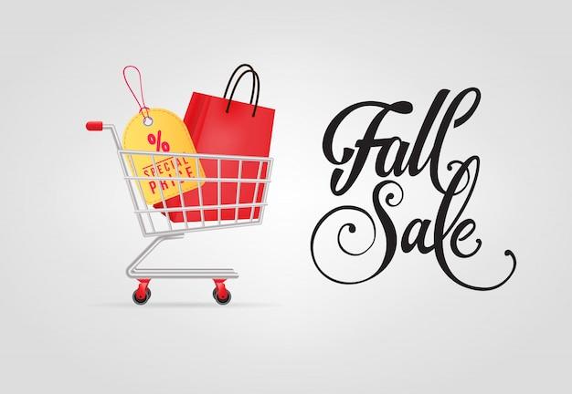 Letras de venta de otoño con bolsa de compras y etiqueta en el carrito