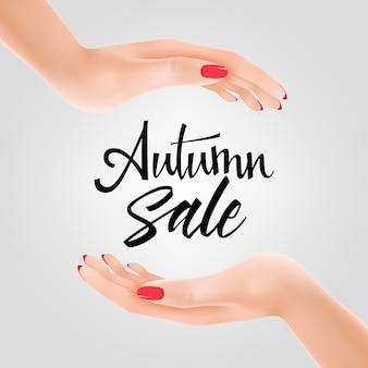 Letras de venta de otoño entre dos manos