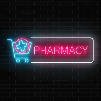 Letrero brillante de farmacia de neón con cruz médica en carro de compras en pared de ladrillo