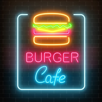 Letrero brillante de neón burger cafe en una pared de ladrillo oscuro. signo de cartelera ligera de comida rápida.
