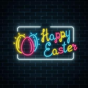 Letrero de feliz pascua de neón brillante con huevos y letras en la pared de ladrillo oscuro