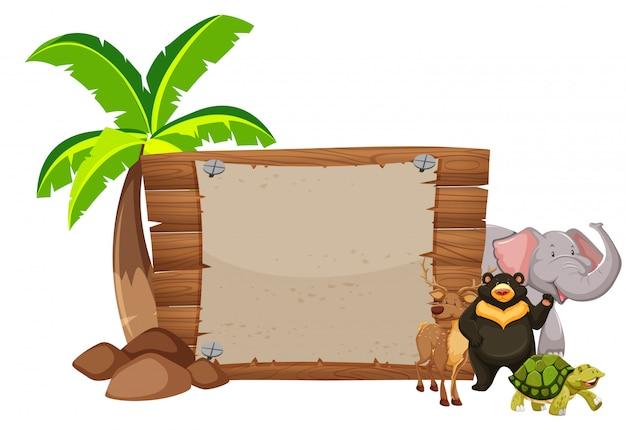 Letrero de madera y animales salvajes
