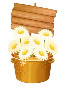 Letrero de madera y flores blancas