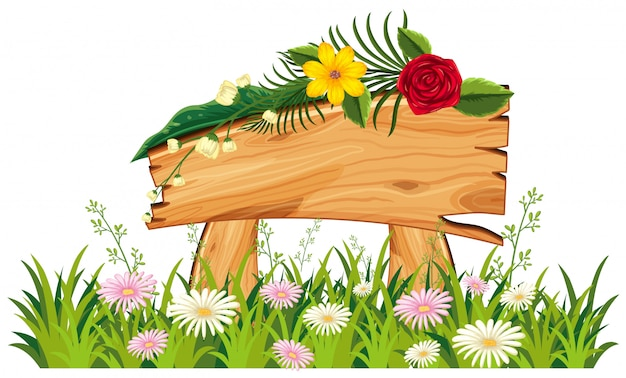 Letrero de madera en pasto con flores