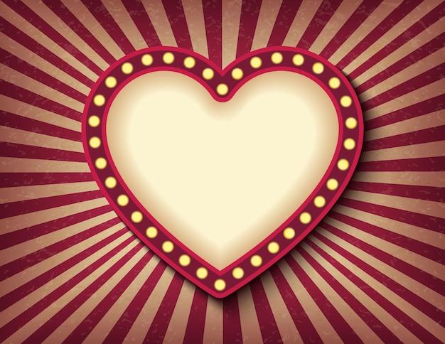 Letrero de neón de cine retro de corazón que brilla intensamente. estilo circense de san valentín