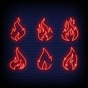 Letrero de neón de llama en pared de ladrillo
