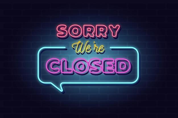 Letrero de neón 'lo siento, estamos cerrados' en la pared de ladrillo