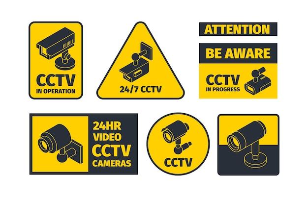 Letreros de circuito cerrado de televisión amarillo y negro.