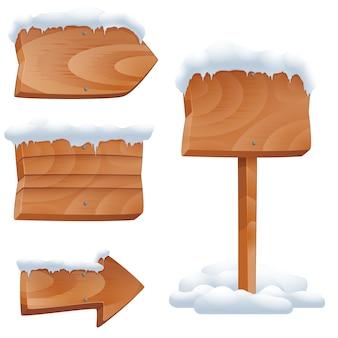 Letreros de madera en conjunto de vectores de nieve. flecha de cartelera, poste de invierno en blanco. letreros de madera con ilustración de vector de nieve
