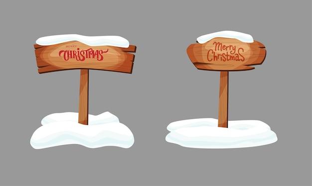 Letreros o tablones de madera de diferentes texturas con nieve. feliz navidad texto de letras a mano.