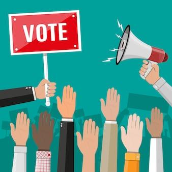 Levantó las manos. la gente vota manos.