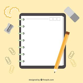 Libreta con accesorios en diseño plano