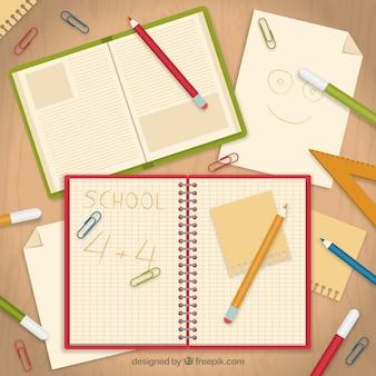 Libreta escolar con papeles