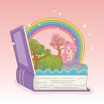 Libro abierto con sirena de cuento de hadas y arco iris.