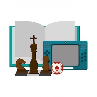 Libro abierto con videojuego portátil y piezas de ajedrez.