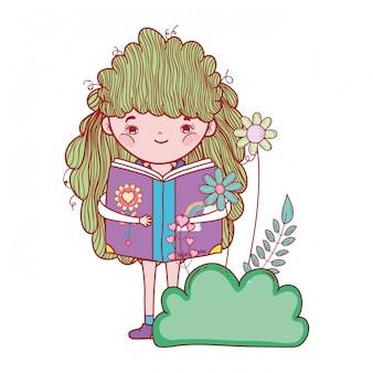 Libro de lectura feliz de la niña en el jardín