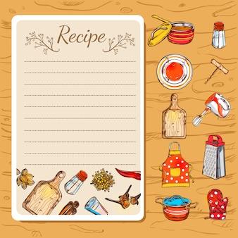 Libro de recetas y utensilios de cocina