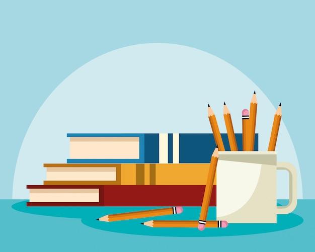 Libros académicos con taza con lapices