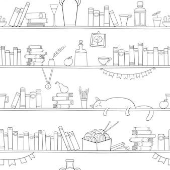 Libros, gatos y otras cosas en los estantes.