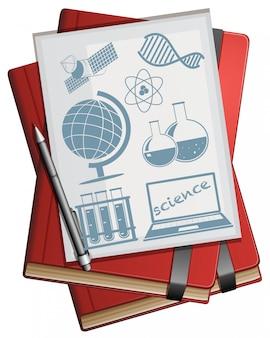 Libros y papel con símbolos de la ciencia.