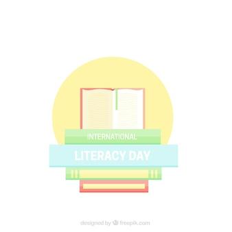 Libros sobre círculo amarillo para celebrar el día de la alfabetización