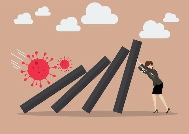 Líder de mujer de negocios ayuda a empujar fichas de dominó que caen en el colapso económico del virus covid-19. concepto de negocio