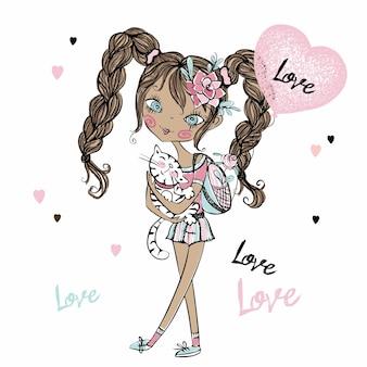 Linda adolescente fashionista con su gatito y un globo en forma de corazón. día de san valentín