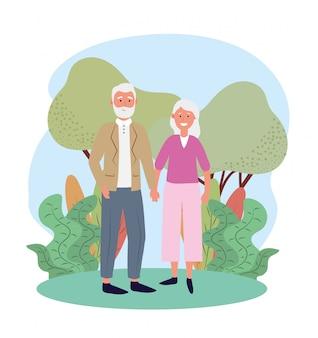 Linda anciana y hombre pareja con árboles y plantas