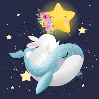 Linda ballena con conejito volando en el espacio