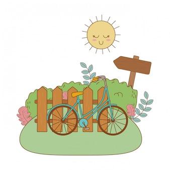 Linda bicicleta retro con valla en el campo
