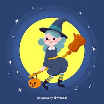 Linda bruja de halloween sentada en una escoba en la noche