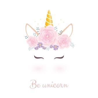 Linda cabeza de unicornio con corona de flores.