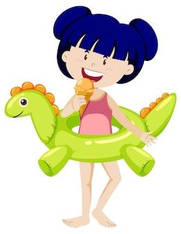 Linda chica con anillo de natación de dinosaurio aislado