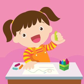 Linda chica dibujando con lápices de colores