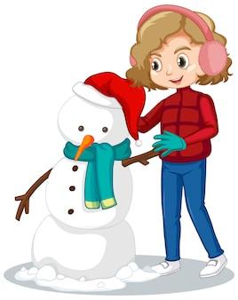 Linda chica haciendo muñeco de nieve en el campo de nieve