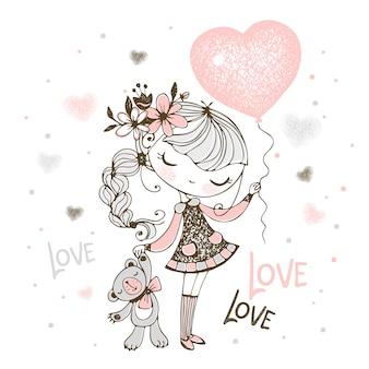 Linda chica con un oso de peluche y un globo en forma de corazón. enamorado.