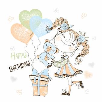 Linda chica con un oso de peluche y un globo en forma de corazón. feliz cumpleaños .