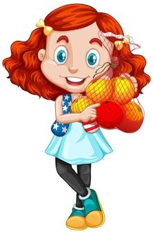 Linda chica con pelo rojo sosteniendo frutas en posición de pie