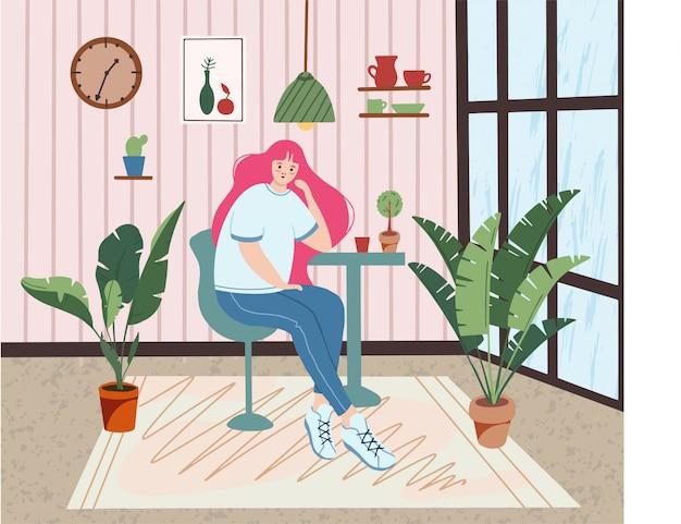 Linda chica plana sentada en la cafetería