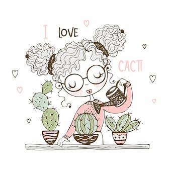 Linda chica está regando los cactus en macetas.