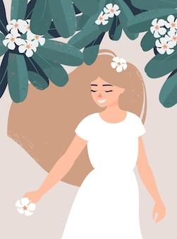 Linda chica rubia bajo un árbol de frangipanis en flor