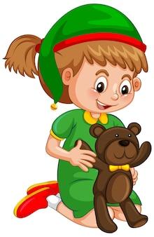 Linda chica con sombrero de navidad y sosteniendo un oso de peluche en blanco