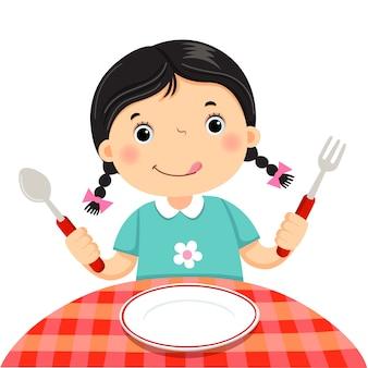 Linda chica sosteniendo una cuchara y tenedor con plato blanco vacío sobre fondo blanco.