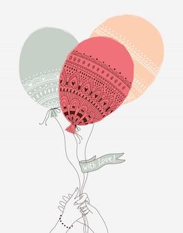 Linda ilustración con las manos sosteniendo los globos. con amor.