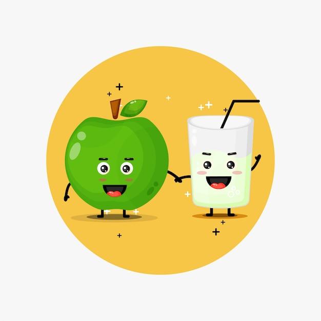 Linda manzana verde y mascota de jugo de manzana verde tomados de la mano