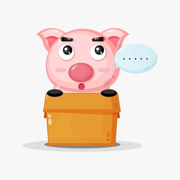 Linda mascota de cerdo en la caja