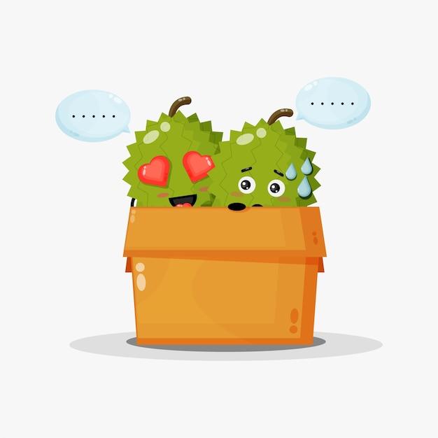 Linda mascota durian en la caja.