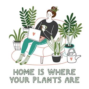 Linda mujer joven sentada en la silla con una computadora portátil en casa con plantas que crecen en macetas